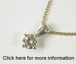 £1350 0.49ct Diamond pendant & chain